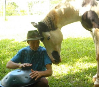 Doug and Echo enjoing a soulful moment during a horse and musician get together at Aurora Valley, run by Beate Somer.