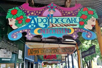 Colourful signs are part of the unique character of Nimbin's Cullen Street.