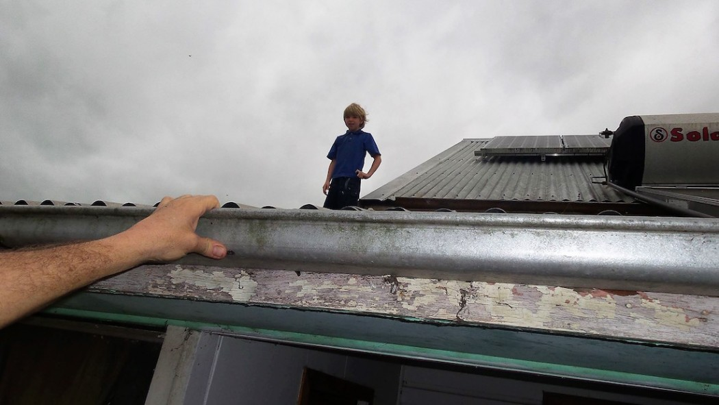 Rescuing a young boy from his roof in Alexandra Parade, Lismore.  Photo: Melissa Gulbin